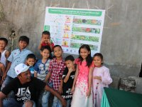 Mandailing kids with the poster produced by the project