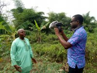 Ireti Emmanuel Adesida doing a video interview with a contact farmer at Akure South Local Government area of Ondo state, Nigeria on e-wallet adoption in Nigeria.